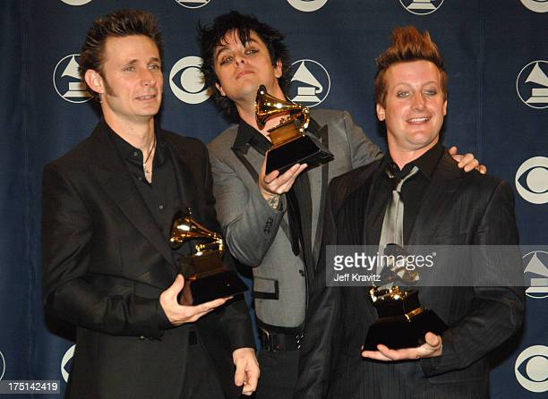 Mike Dirnt Billie Joe Armstrong and Tre Cool of Green Day winner Record Of The Year for Boulevard Of Broken Dreams
