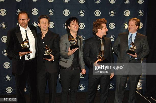 Mike Dirnt Billie Joe Armstrong and Tre Cool of Green Day winner Record Of The Year for Boulevard Of Broken Dreams with Rob Cavallo and guest