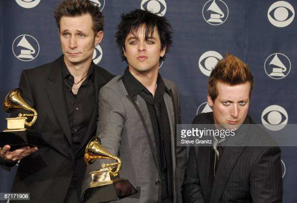 Mike Dirnt Billie Joe Armstrong and Tre Cool of Green Day winners of Record Of The Year for Boulevard Of Broken Dreams