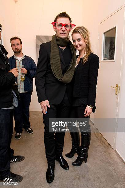Mike Dirnt of Green Day and Britney Dirnt attend exhibition 21st Century Breakdown The Art Of Rock at Old Truman Brewery on October 22 2009 in London...