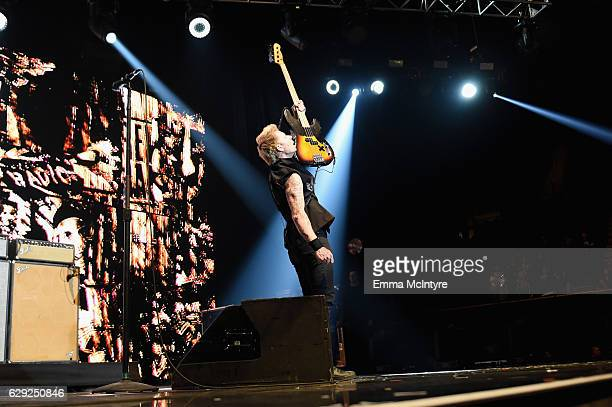 Mike Dirnt of the band Green Day performs onstage at 1067 KROQ Almost Acoustic Christmas 2016 Night 2 at The Forum on December 11 2016 in Inglewood...