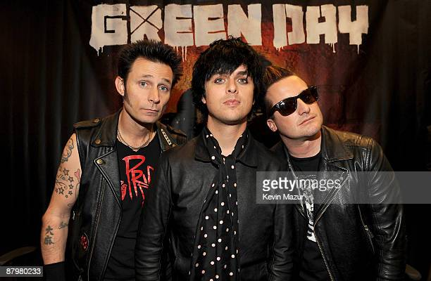 NEW YORK MAY 15 Mike Dirnt Tré Cool and Billie Joe Armstrong of Green Day promote 21st Centruty Breakdown at Best Buy 5th Avenue on May 15 2009 in...