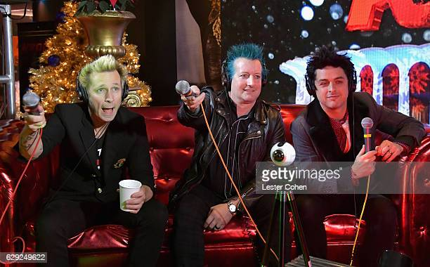 Mike Dirnt Tre Cool and Billie Joe Armstrong of the band Green Day attend 1067 KROQ Almost Acoustic Christmas 2016 Night 2 at The Forum on December...
