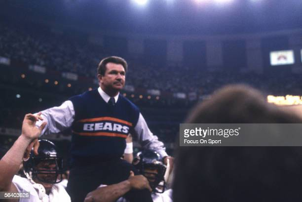Mike Ditka head coach of the Chicago Bears is held up by two of his teammates after defeating the the New England Patriots for Super Bowl XX at the...