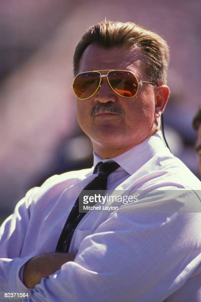 Mike Ditka, head coach of the Chicago Bears, watches before a NFL football game against the Cincinnati Bengals on September 10, 1989 at Soldier Field...