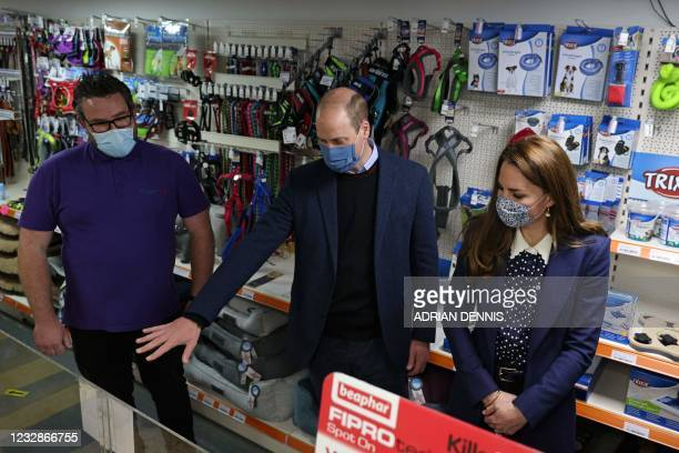 Mike Dixon , Director of B2B & B2C Pet Supply divisions greets Britain's Prince William, Duke of Cambridge , and Britain's Catherine, Duchess of...