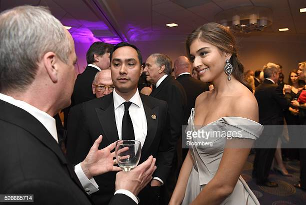 Mike Dorning from left Representative Joaquin Castro a Democrat from Texas and model Daniela Lopez attend the Bloomberg cocktail party before the...