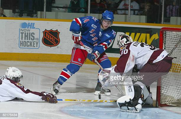 Mike Duco of the Kitchener Rangers attempts a shot on Eero Kilpelainen of the Peterborough Petes at Peterborough Memorial Centre on January 27, 2005...
