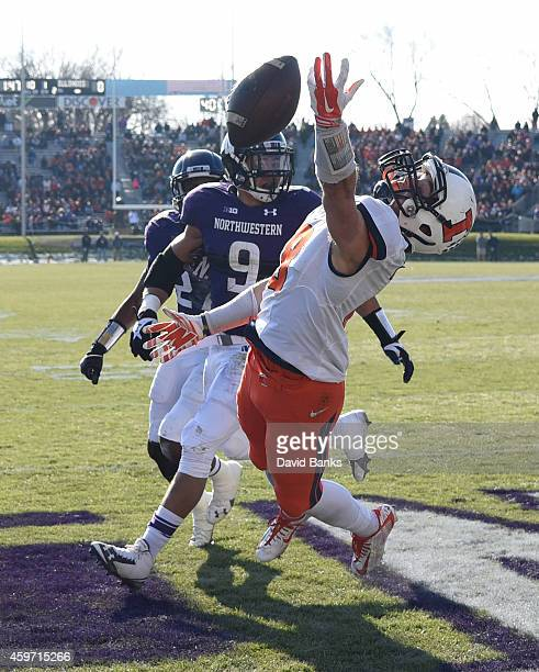 Mike Dudek of the Illinois Fighting Illini can't make a catch as he's defended by Jimmy Hall of the Northwestern Wildcats during the first half on...
