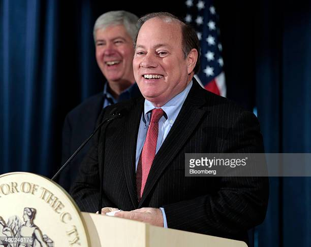Mike Duggan, mayor of Detroit, speaks during a news conference with Rick Snyder, governor of Michigan, back left, at police headquarters in Detroit,...