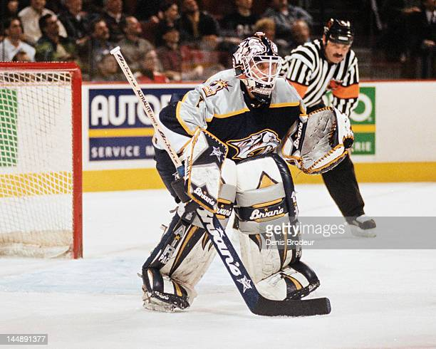 Mike Dunham of the Nashville Predators follows the action during a game against the Montreal Canadiens Circa 2002 at the Bell Centre in Montreal,...