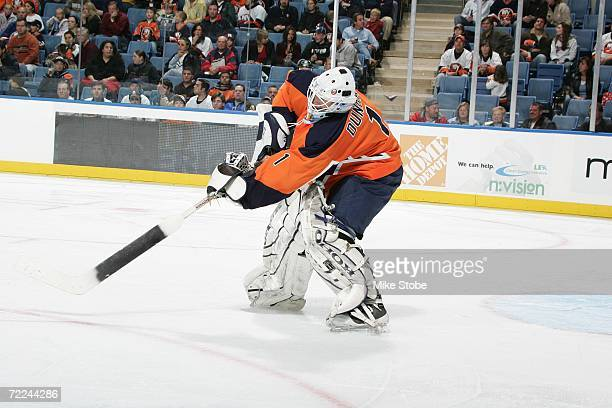 Mike Dunham of the New York Islanders passes against the Boston Bruins on October 14, 2006 at Nassau Coliseum in Uniondale, New York. The Islanders...