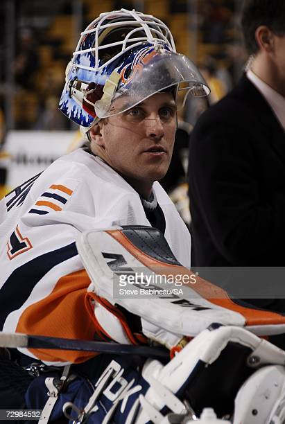 Mike Dunham of the New York Islanders stretches during warmups before the game against the Boston Bruins at the TD Banknorth Garden on January 11,...