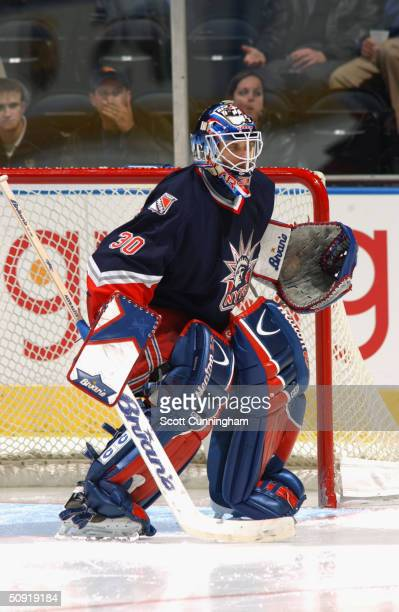 Mike Dunham of the New York Rangers eyes the play from the top of the crease against the Atlanta Thrashers on March 9, 2004 at Philips Arena in...