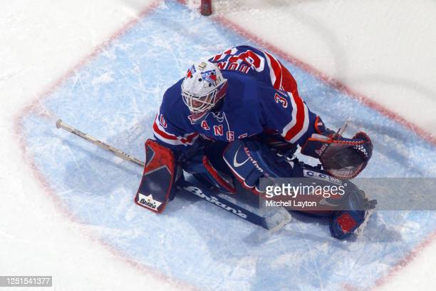 Mike Dunham of the New York Rangers in position during a NHL hockey game against the Washington Capitals at MCI Center on January 15, 2003 in...