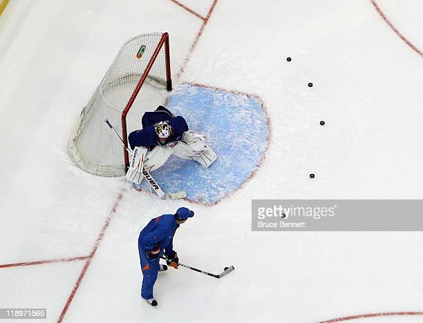 Mike Dunham works with goaltender Anders Nilsson of the New York Islanders at the prospects evaluation camp at Nassau Veterans Memorial Coliseum on...
