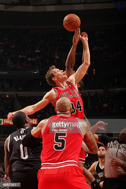 Mike Dunleavy of the Chicago Bulls battles for a jump ball with Derron Williams of the Brooklyn Nets on February 13 2014 at the United Center in...