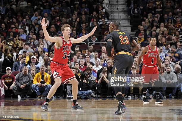 Mike Dunleavy of the Chicago Bulls defends against LeBron James of the Cleveland Cavaliers on February 18 2016 at Quicken Loans Arena in Cleveland...