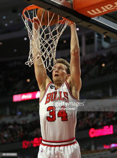 Mike Dunleavy of the Chicago Bulls dunks against the Orlando Magic on his way to a gamehigh 22 points at the United Center on April 14 2014 in...