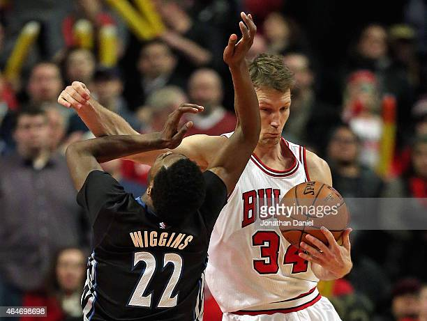 Mike Dunleavy of the Chicago Bulls fouls Andrew Wiggins of the Minnesota Timberwolves at the United Center on February 27 2015 in Chicago Illinois...