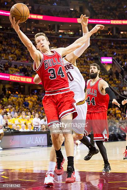 Mike Dunleavy of the Chicago Bulls grabs a rebound against Timofey Mozgov of the Cleveland Cavaliers in the first half during Game One in the Eastern...