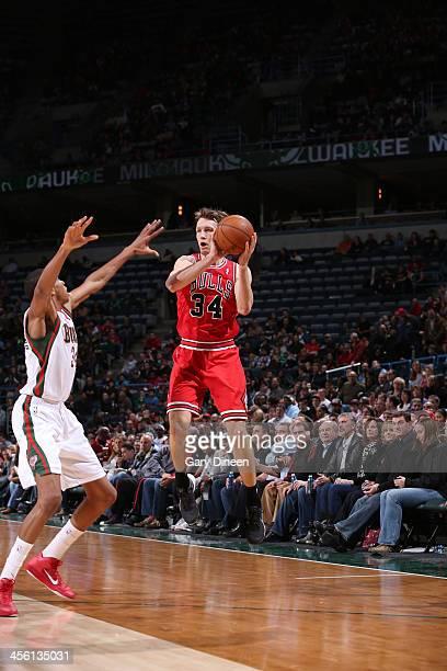 Mike Dunleavy of the Chicago Bulls passes against Giannis Antetokounmpo of the Milwaukee Bucks on December 13 2013 at the BMO Harris Bradley Center...