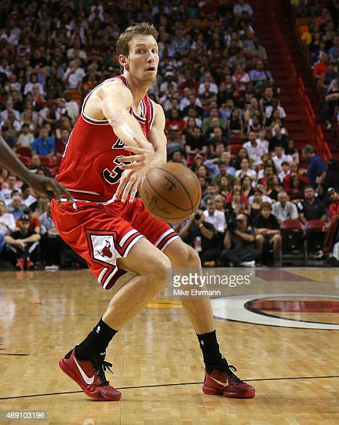 Mike Dunleavy of the Chicago Bulls passes during a game against the Miami Heat at American Airlines Arena on April 9 2015 in Miami Florida NOTE TO...