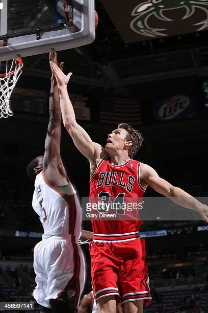 Mike Dunleavy of the Chicago Bulls shoots against Ekpe Udoh of the Milwaukee Bucks on December 13 2013 at the BMO Harris Bradley Center in Milwaukee...