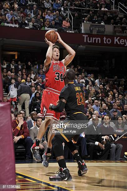 Mike Dunleavy of the Chicago Bulls shoots against LeBron James of the Cleveland Cavaliers on February 18 2016 at Quicken Loans Arena in Cleveland...