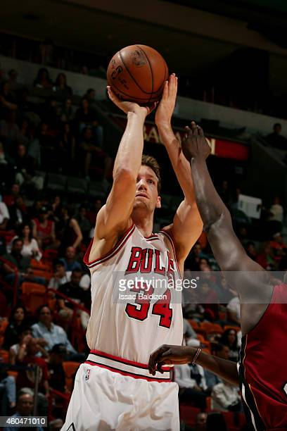 Mike Dunleavy of the Chicago Bulls shoots against the Miami Heat on December 14 2014 at American Airlines Arena in Miami Florida NOTE TO USER User...