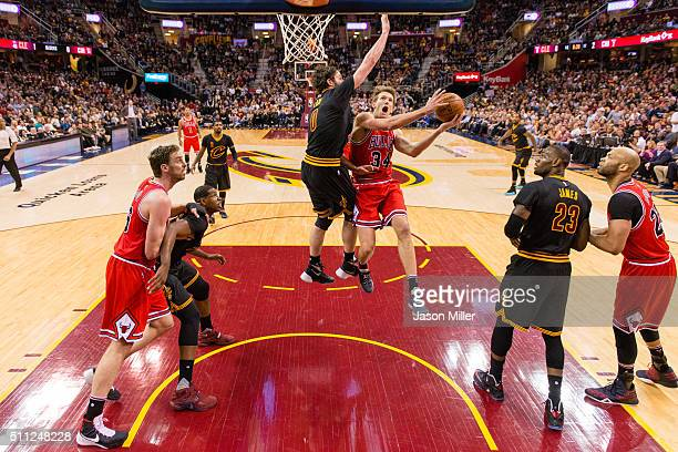 Mike Dunleavy of the Chicago Bulls shoots over Kevin Love of the Cleveland Cavaliers during the first half at Quicken Loans Arena on February 18 2016...