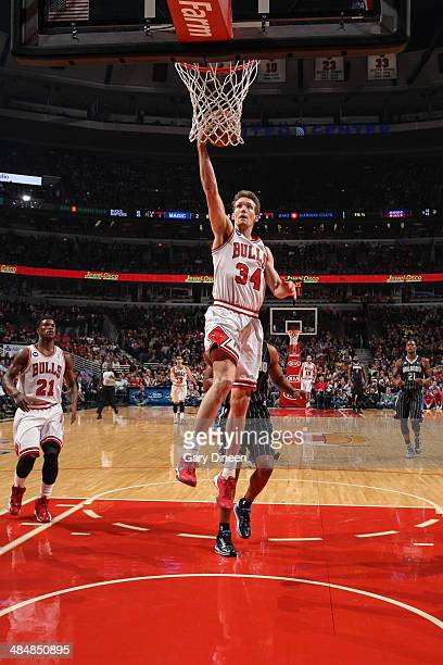 Mike Dunleavy of the Chicago Bulls takes the ball to the basket against the Orlando Magic on April 14 2014 at the United Center in Chicago Illinois...