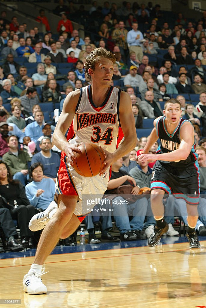 Mike Dunleavy #34 of the Golden State Warriors drives against the Memphis Grizzlies during the game at the Arena in Oakland on January 12, 2004 in Oakland, California. The Grizzlies won in double overtime 115-113.
