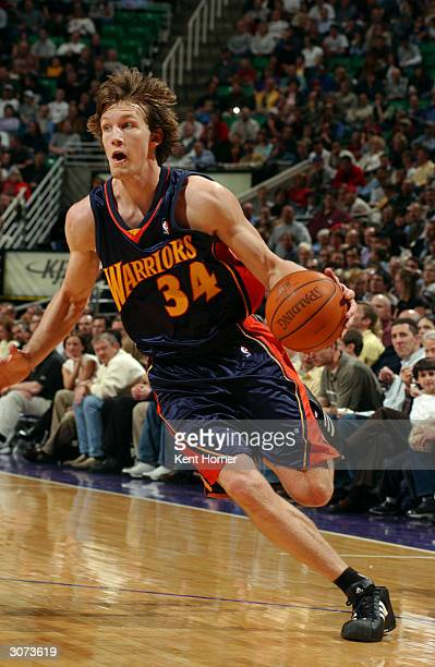 Mike Dunleavy of the Golden State Warriors drives to the basket against the Utah Jazz on March 10 2004 at the Delta Center in Salt Lake City Utah...