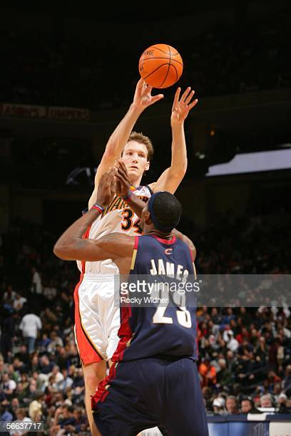 Mike Dunleavy of the Golden State Warriors passes the ball over Lebron James of the Cleveland Cavaliers on January 20 2006 at the Arena in Oakland...