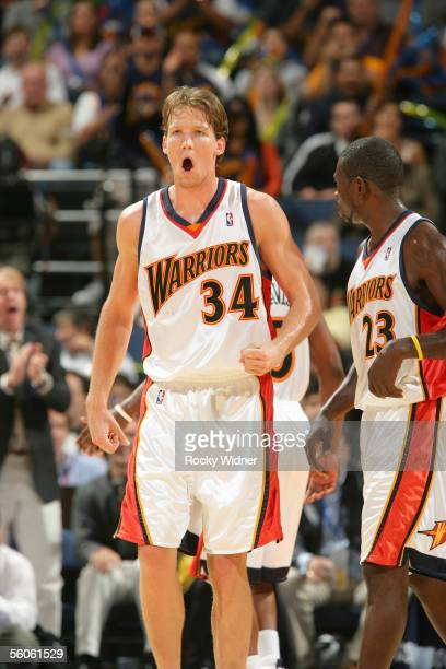 Mike Dunleavy of the Golden State Warriors pumps his fist as he stands on court against the Atlanta Hawks on November 2 2005 at the Arena in Oakland...
