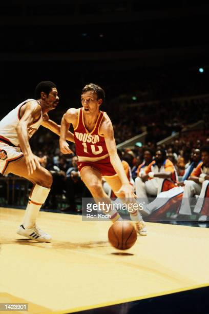 Mike Dunleavy of the Houston Rockets drives to the basket against the Denver Nuggets during the NBA game at McNichols Sports Arena in Denver Colorado...