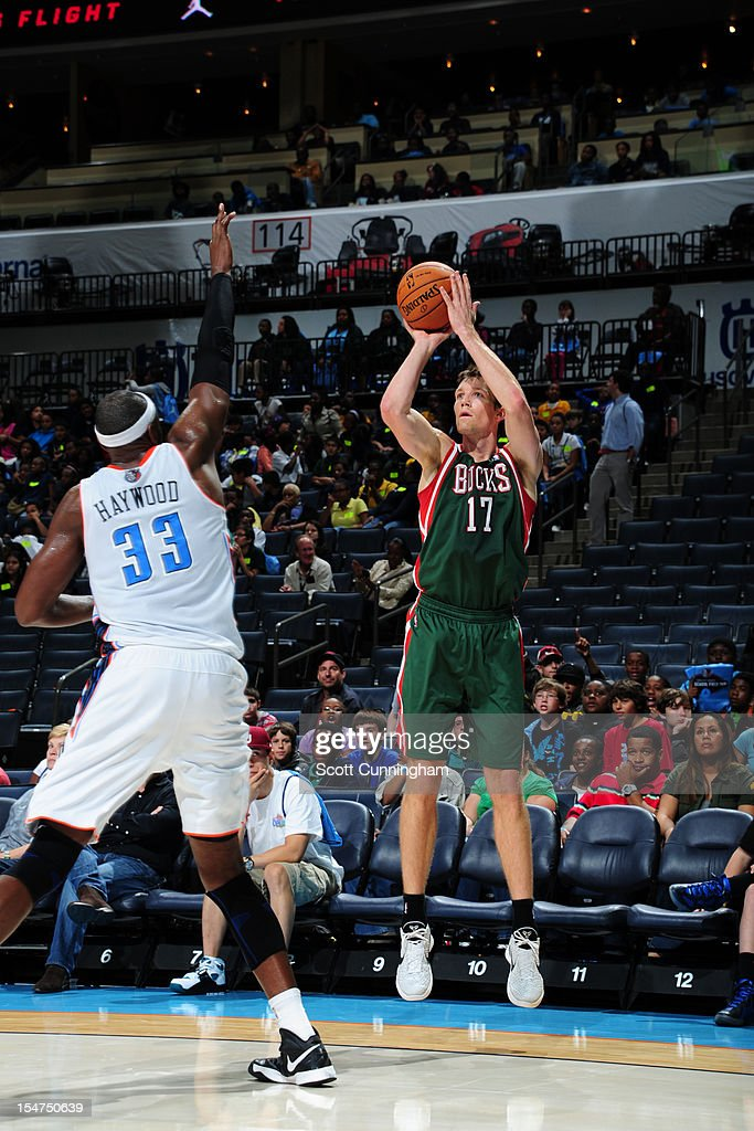 Mike Dunleavy #17 of the Milwaukee Bucks shoots against Brendan Haywood #33 of the Charlotte Bobcats at the Time Warner Cable Arena on October 25, 2012 in Charlotte, North Carolina.