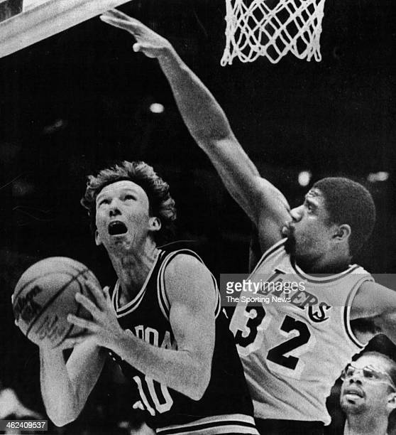 Mike Dunleavy of the San Antonio Spurs against Earvin 'Magic' Johnson of the Los Angeles Lakers circa 1983