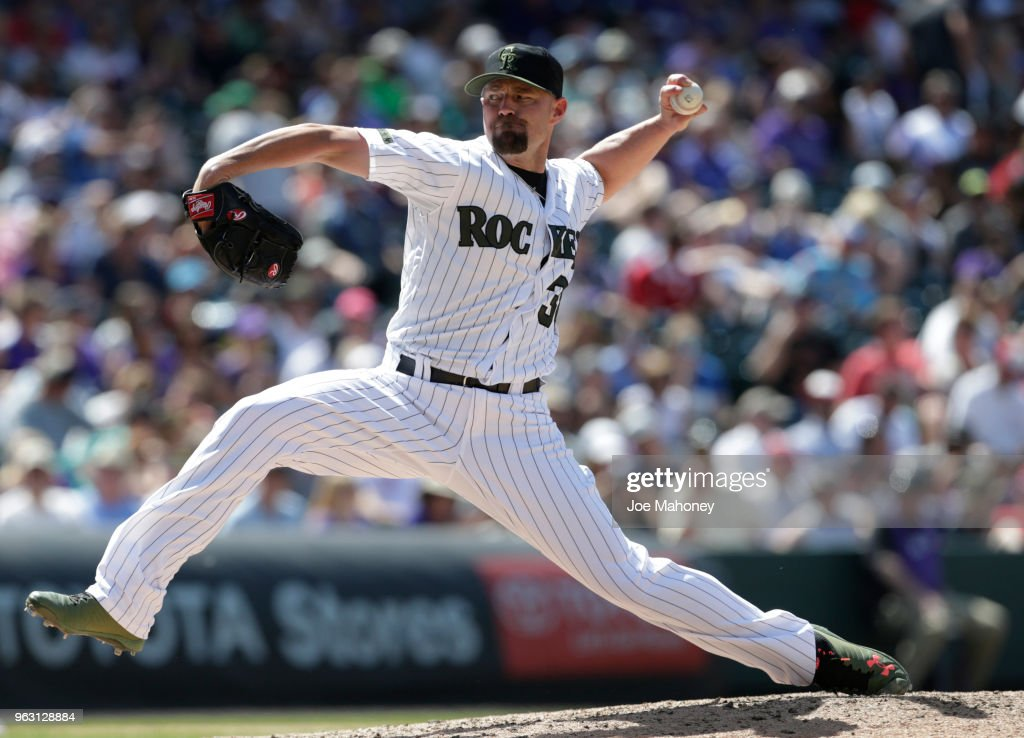 Mike Dunn #38 of the Colorado Rockies pitches against the Cincinnati Reds in the eighth inning at Coors Field on May 27, 2018 in Denver, Colorado. The Rockies won 8-2.