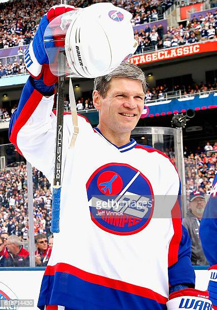 Mike Eagles of the Winnipeg Jets alumni team acknowledges the crowd during team introductions for the 2016 Tim Hortons NHL Heritage Classic Alumni...