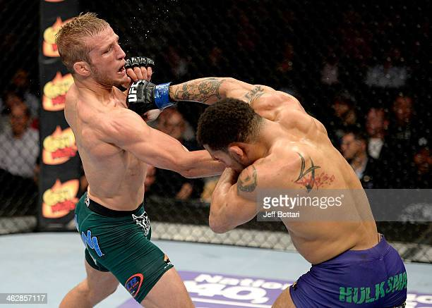 Mike Easton punches TJ Dillashaw in their bantamweight fight during the UFC Fight Night event inside The Arena at Gwinnett Center on January 15, 2014...
