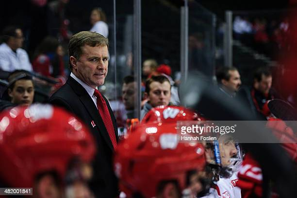 Mike Eaves of the Wisconsin Badgers looks on during the semifinal game of the Big Ten Men's Ice Hockey Championship against the Penn State Nittany...