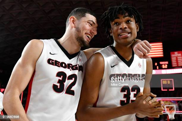 Mike Edwards and Nicolas Claxton of the Georgia Bulldogs embrace as they walk off the floor following the Bulldogs' win over the Tennessee Volunteers...