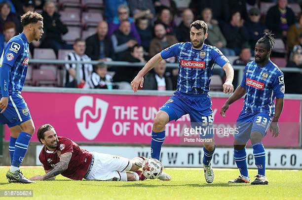 Mike Edwards of Notts County moves forward with the ball from Ricky Holmes of Northampton Town during the Sky Bet League Two match between...