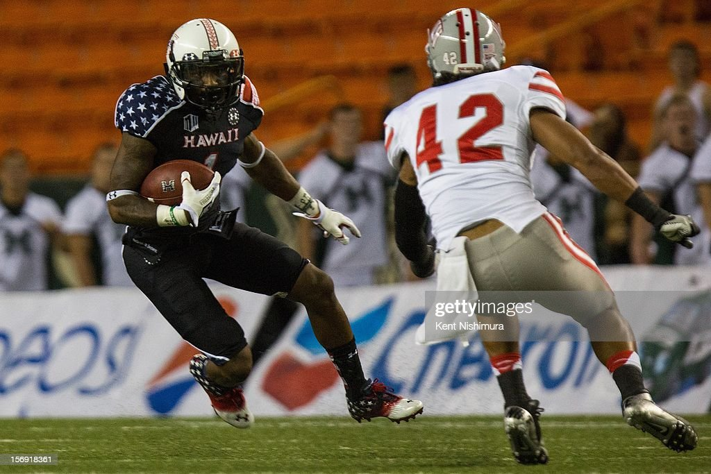 Mike Edwards #1 of the Hawaii Warriors carries the ball against Peni Vea #42 of the UNLV Rebels during a NCAA college football game between the UNLV Rebels and the Hawaii Warriors on November 24, 2012 at Aloha Stadium in Honolulu, Hawaii.