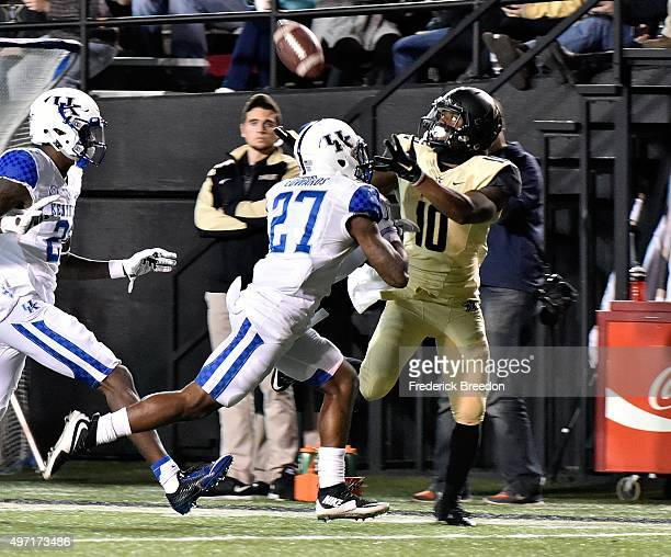 Mike Edwards of the Kentucky Wildcats defends Trent Sherfield of the Vanderbilt Commodores during the second half at Vanderbilt Stadium on November...