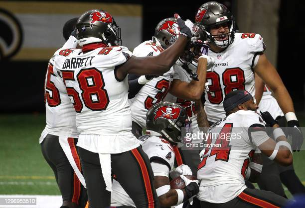Mike Edwards of the Tampa Bay Buccaneers celebrates with his teammates after intercepting a pass thrown by Drew Brees of the New Orleans Saints...