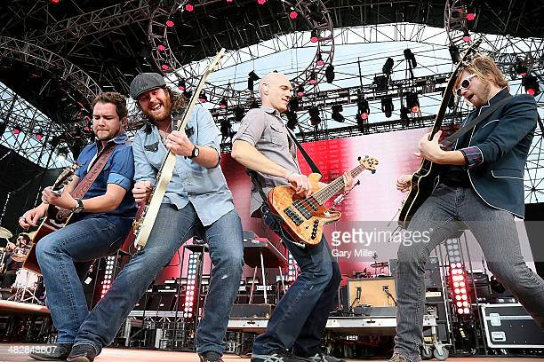 Mike Eli James Young Jon Jones and Cale Richardson of the Eli Young Band perform in concert during the March Madness Music Festival at Reunion Park...