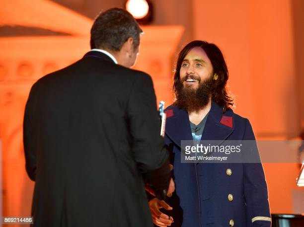 Mike Elizondo accepts award from Jared Leto onstage at Spotify's Inaugural Secret Genius Awards hosted by Lizzo at Vibiana on November 1 2017 in Los...